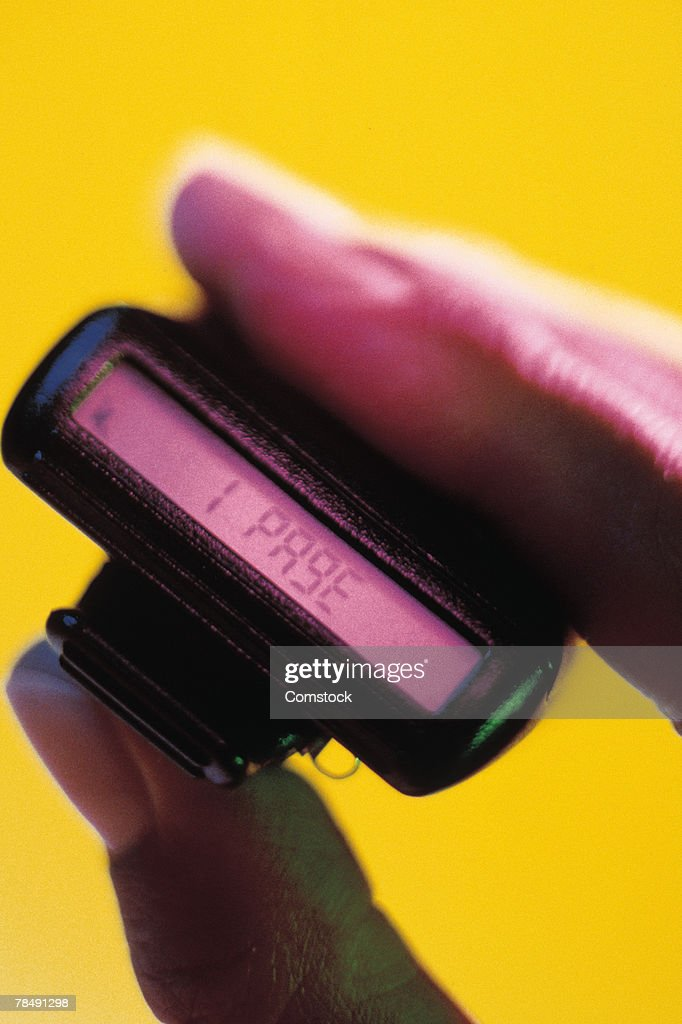 Hand holding a beeper