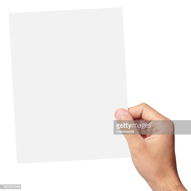 Hand holding a blank piece of paper