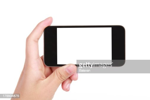 Hand holding a blank smart phone on a white background