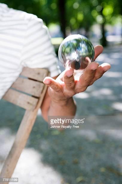 Hand holding a boule ball Stockholm Sweden.