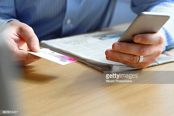 Hand holding a credit card internet shopping