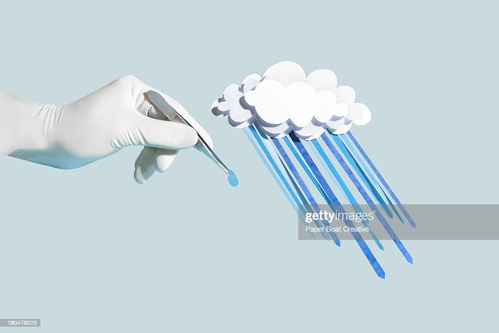 Hand holding a drop of paper craft rain from cloud : Stock Photo