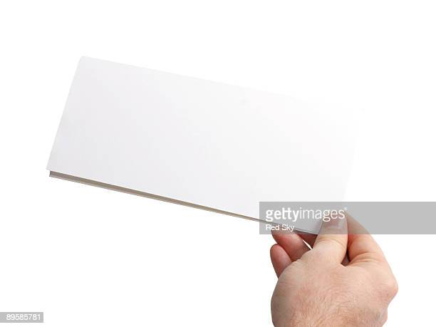 Hand holding a folded piece of paper