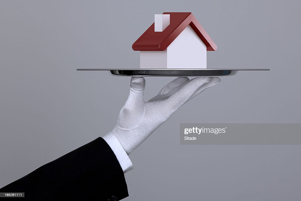 Hand Holding A House In Tray With Clipping Path