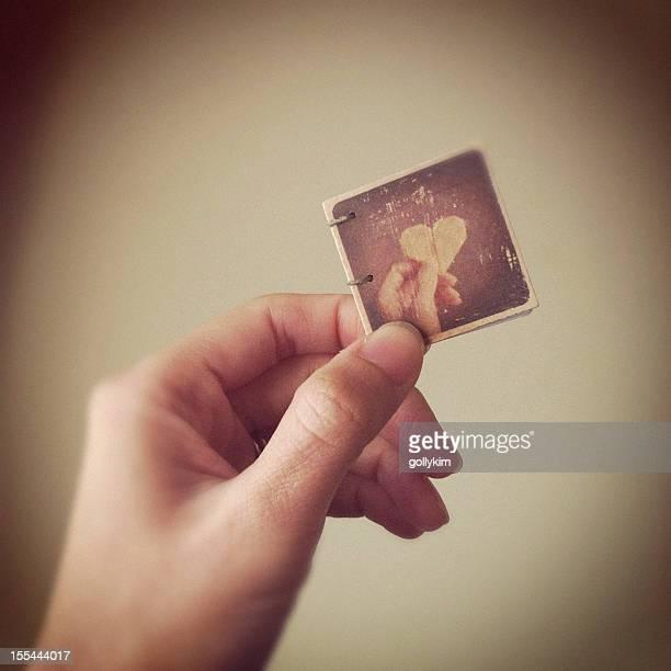 Hand Holding a Miniature Handmade Book