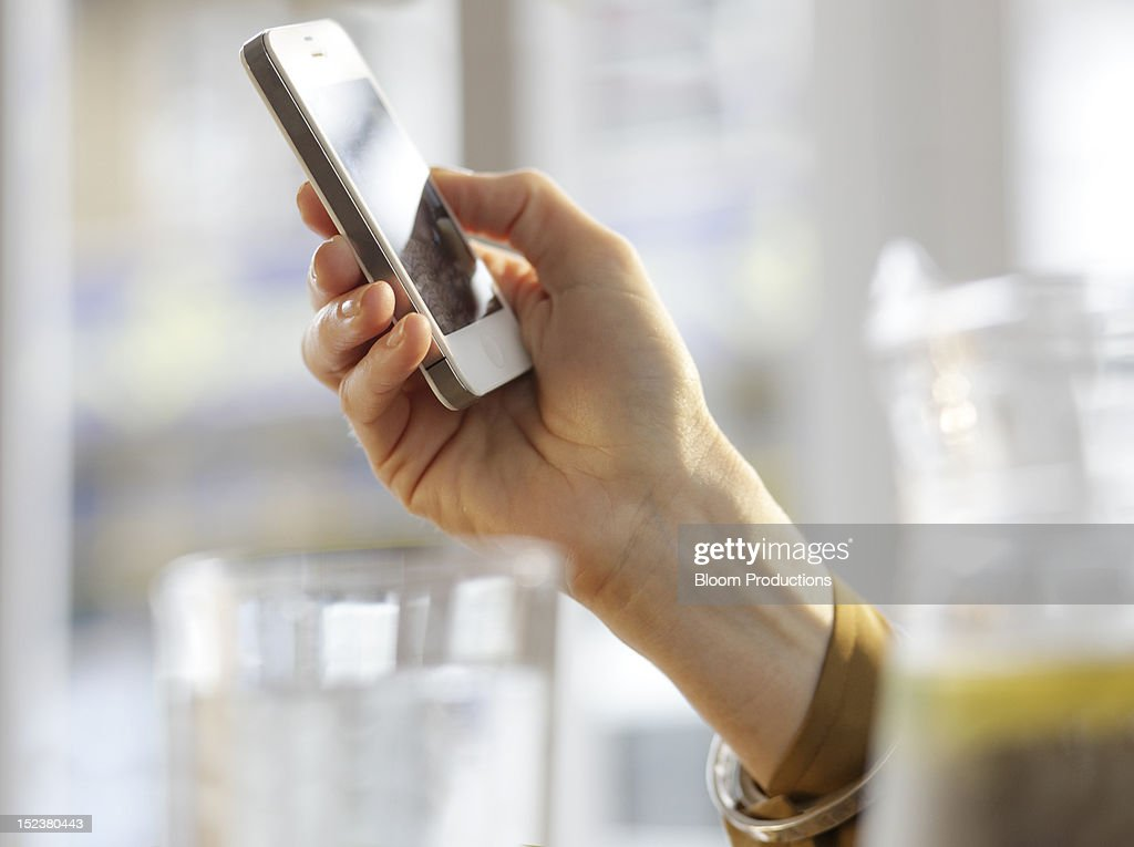 hand holding a mobile, cell phone, smart phone