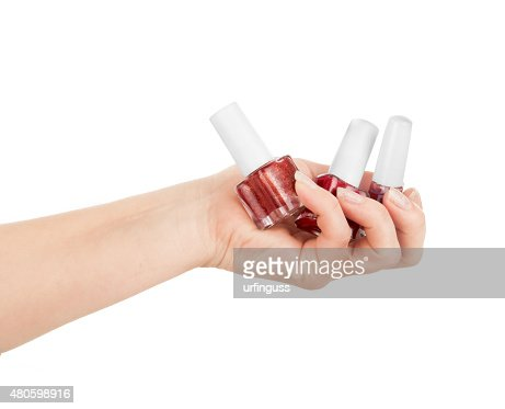 hand holding a nail polishes isolated white : Stock Photo