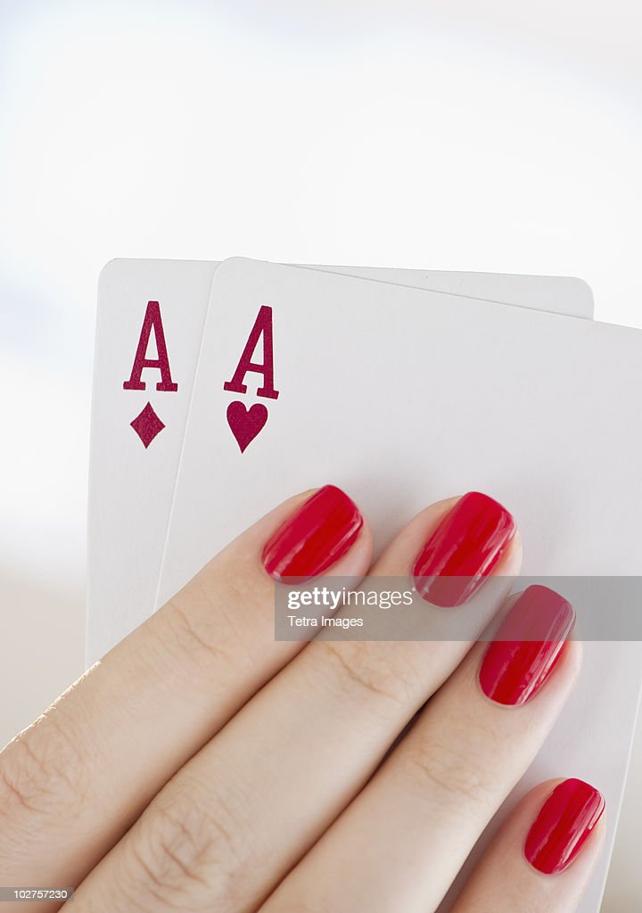 Hand holding a pair of aces