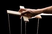 hand holding a puppet cross beam