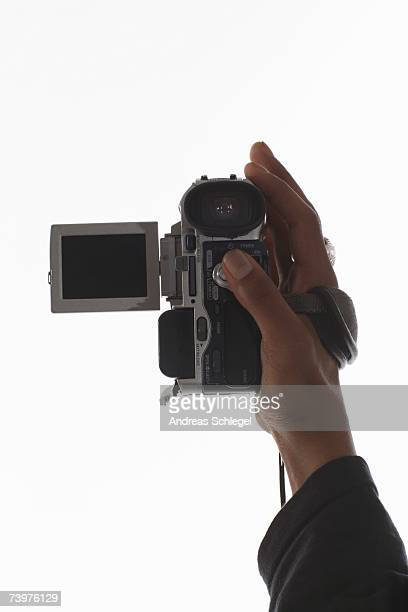 Hand holding a video camera