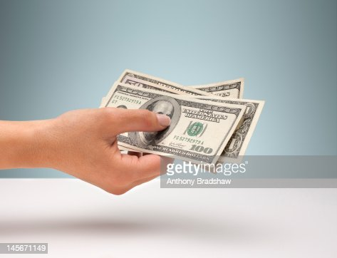 Hand holding American currency : Stockfoto