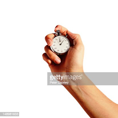 Hand holding an analogue stop watch