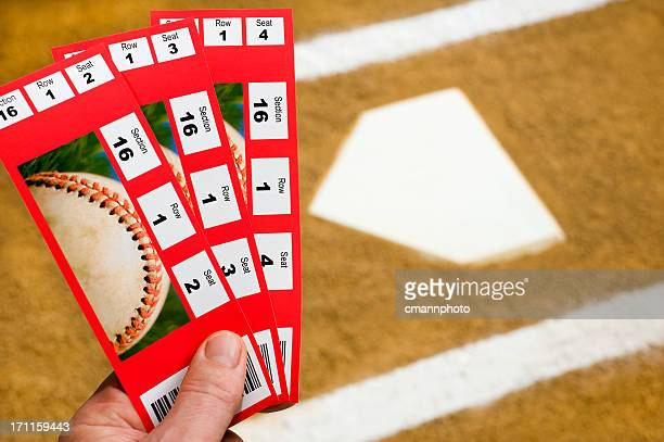 Hand holding Baseball-Tickets at home plate