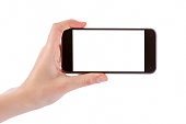 Hand holding black smart phone isolated on white clipping path inside