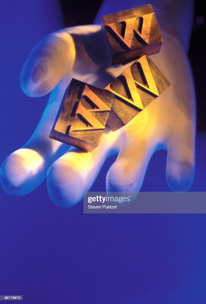 Hand holding blocks with letter www : Stock Photo