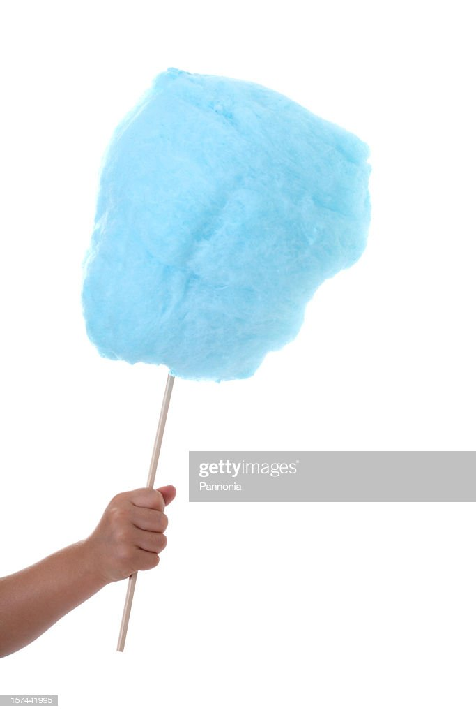 A hand holding blue cotton candy