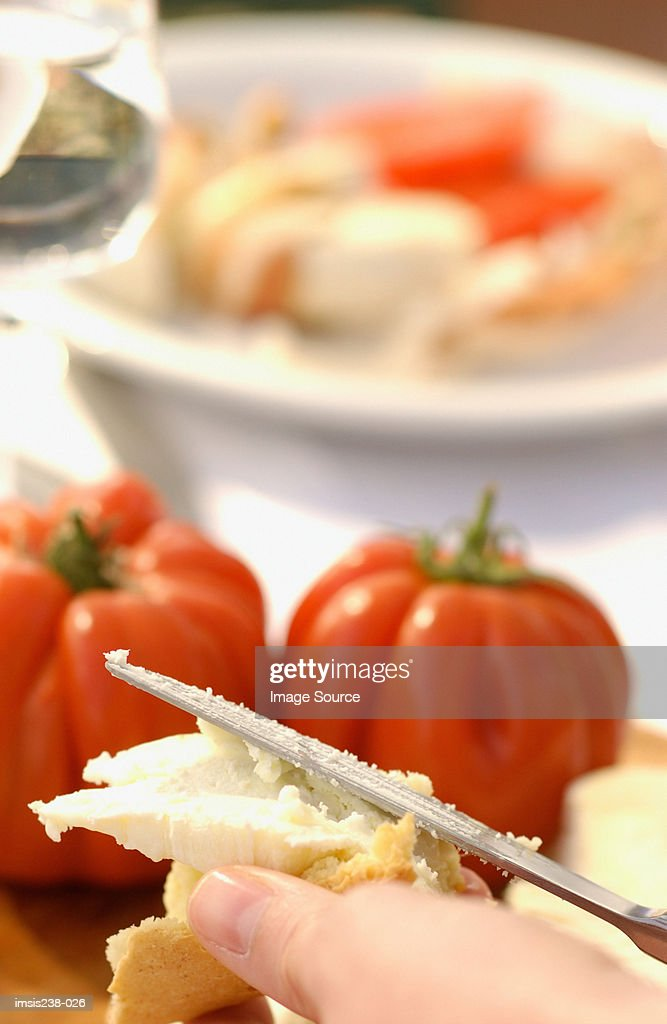 Hand holding bread and cheese : Stock Photo