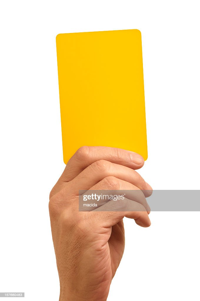 Hand holding bright yellow card against white background