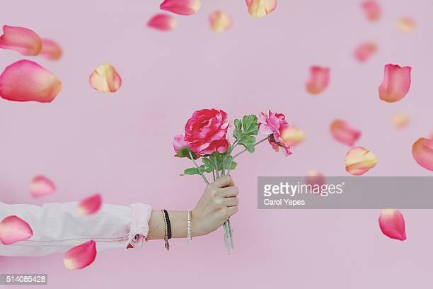 hand holding bunch of  flowers
