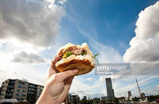 Hand holding burger