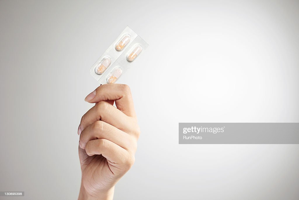 Hand holding capsules,hands close-up