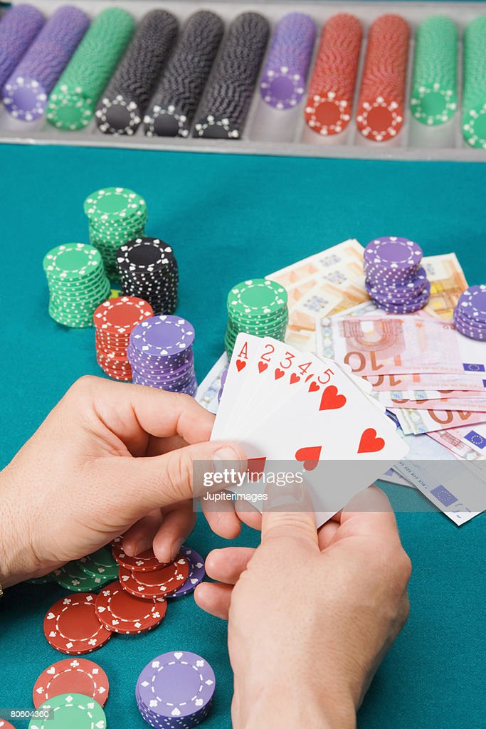 Hand holding cards with straight flush : Stock Photo