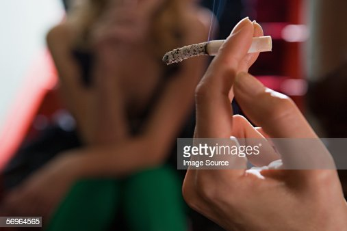 Hand holding cigarette : Stock Photo