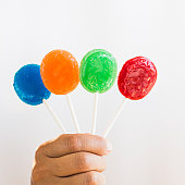 Hand holding colorful lollypops