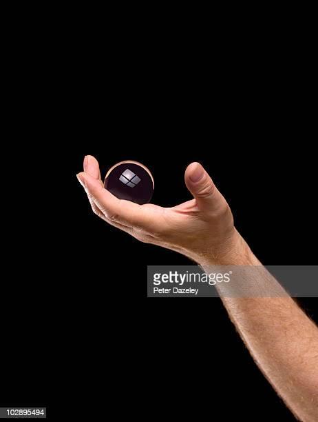 Hand holding crystal ball