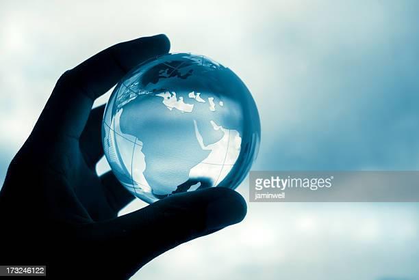 Hand holding crystal globe