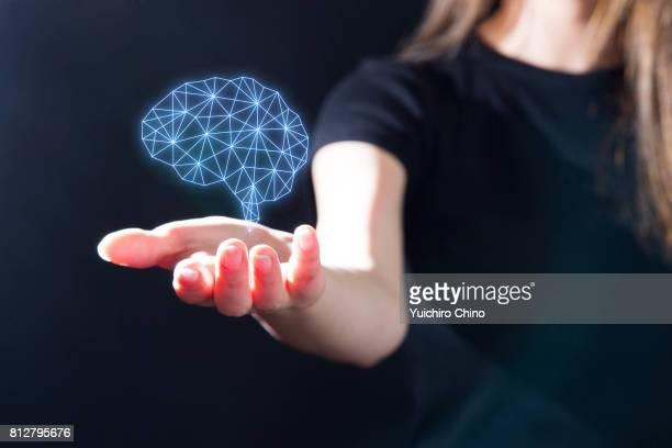 Hand holding digital image of brain
