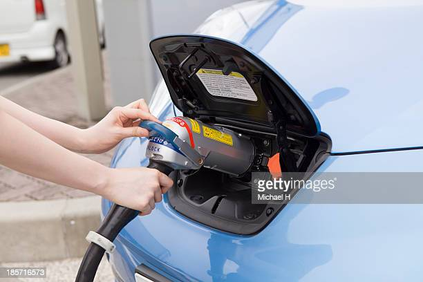hand holding Electric Car Charging nozzle