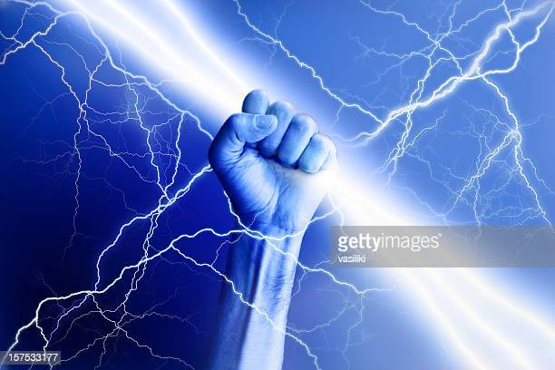 Hand holding electricity beam with rays surrounding