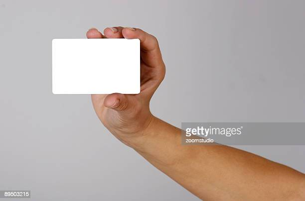 Hand holding empty credit card