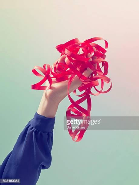 Hand holding entangled string