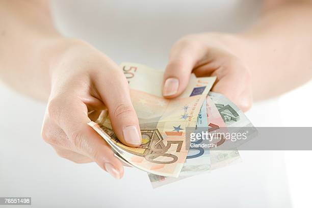 Woman holding Euro notes, close-up