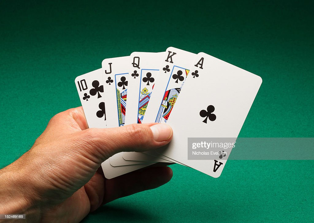 Hand holding five playing cards : Stock Photo
