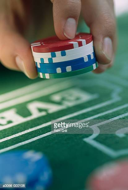 Hand Holding Gambling Chips