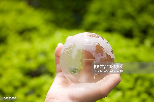 A hand holding globe
