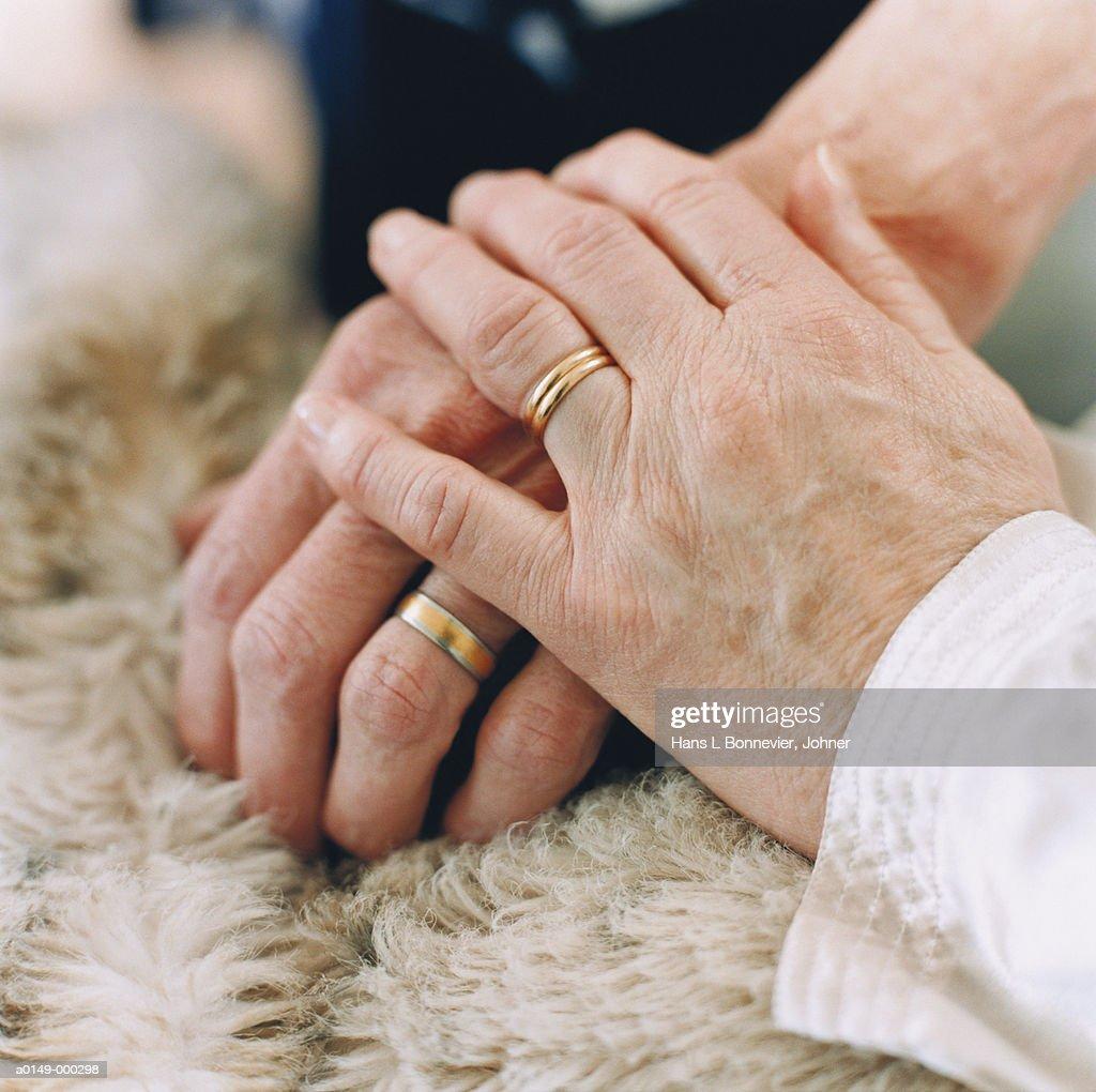 Hand Holding Hand in Comfort : Stock Photo