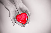 Hand holding beautiful heart.