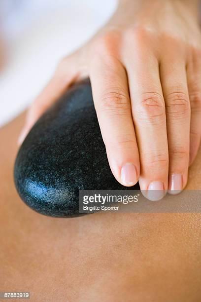 Hand holding hot stone