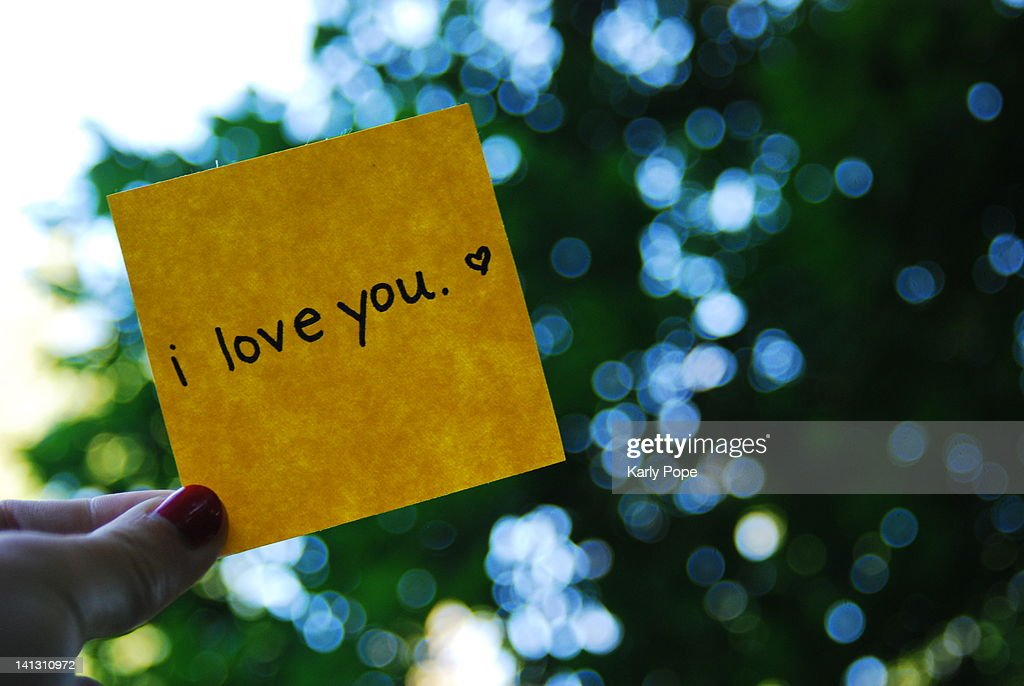 Hand holding I Love You note : Stock Photo