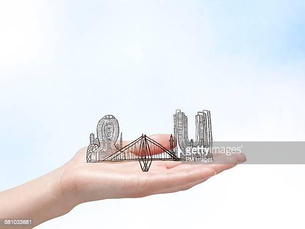 Hand holding illustrated Mumbai