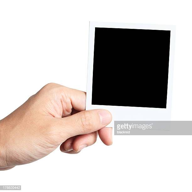 Mano agarrando foto instantánea