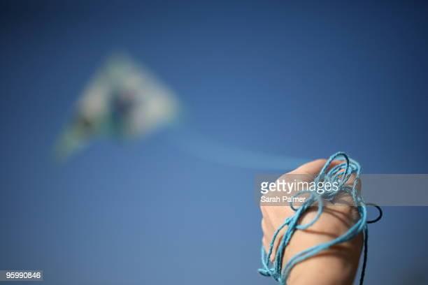 Hand holding kite string