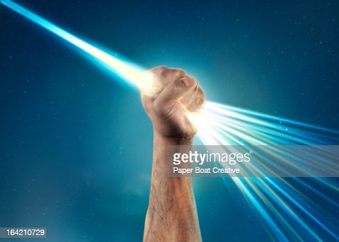 hand holding light laser beam that bursts out
