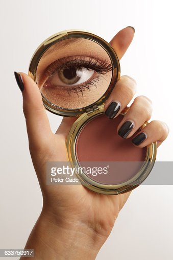 hand holding mirror. hand holding make up mirror with reflection of eye stock photo | getty images n