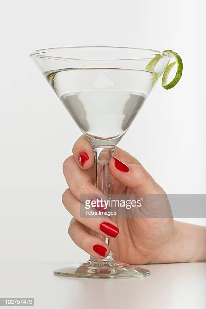 Hand holding martini glass