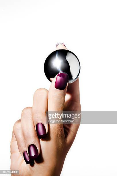 hand holding metal ball